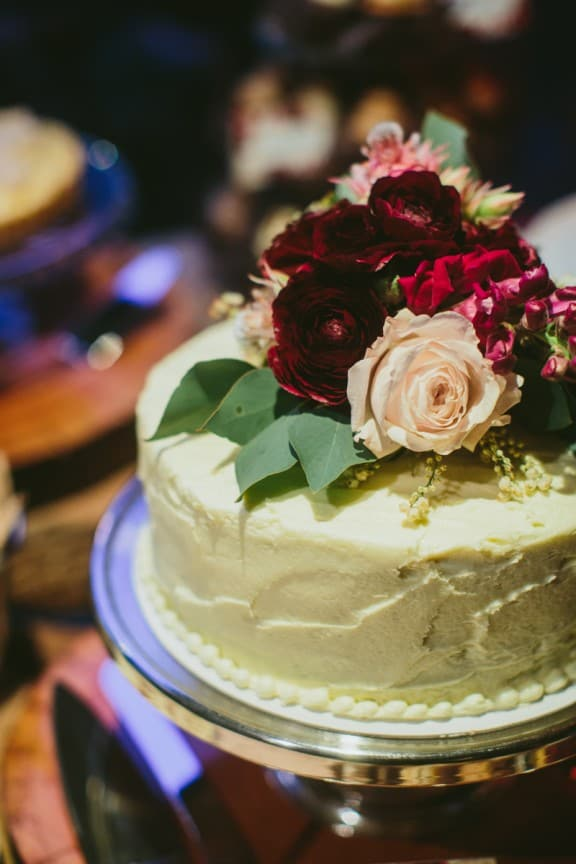 Simple wedding cake topped with fresh flowers | Still Love Photography