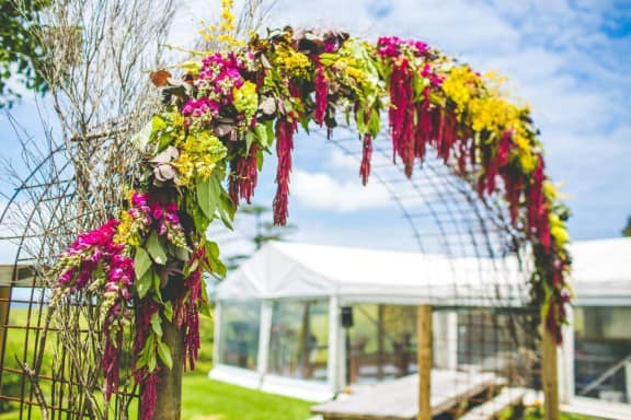 Floral arch by Gypsy Flora | Jess & Nick's Colourful Bush Bank Wedding | Photography by The Evoke Company