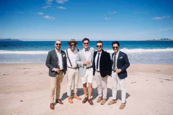Beach groomsmen | Photography by Jonathan Wherrett