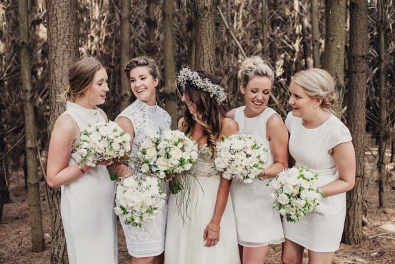 Bridesmaids in white | Photography by Fiona Vail