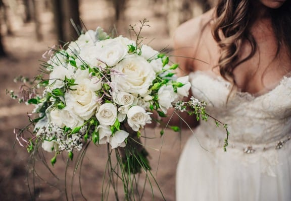 White rose and trailing jasmine bouquet | Photography by Fiona Vail