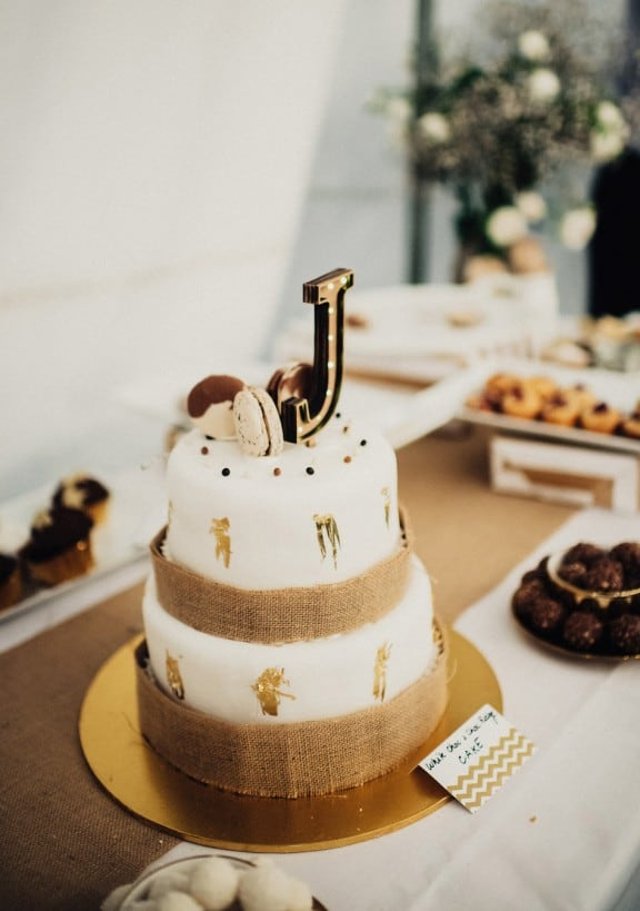 Simple wedding cake with gold leaf | Photography by Fiona Vail
