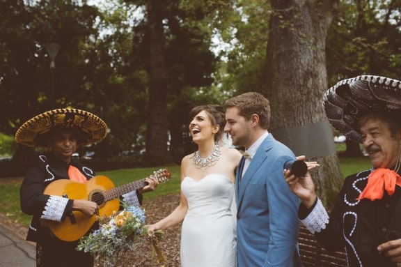Newlyweds serenaded by a mariachi band