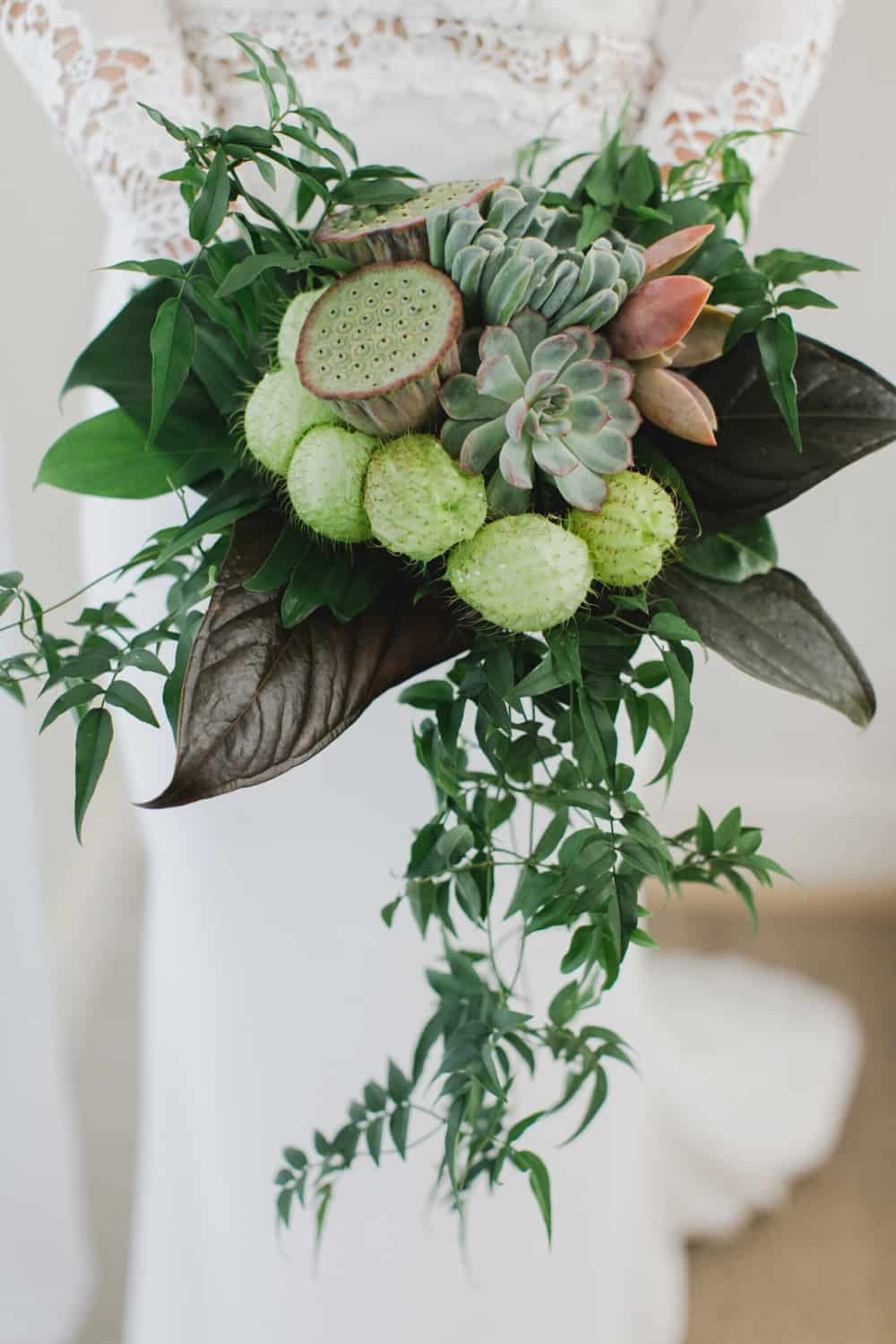 tropical lotus pod and succulent bouquet