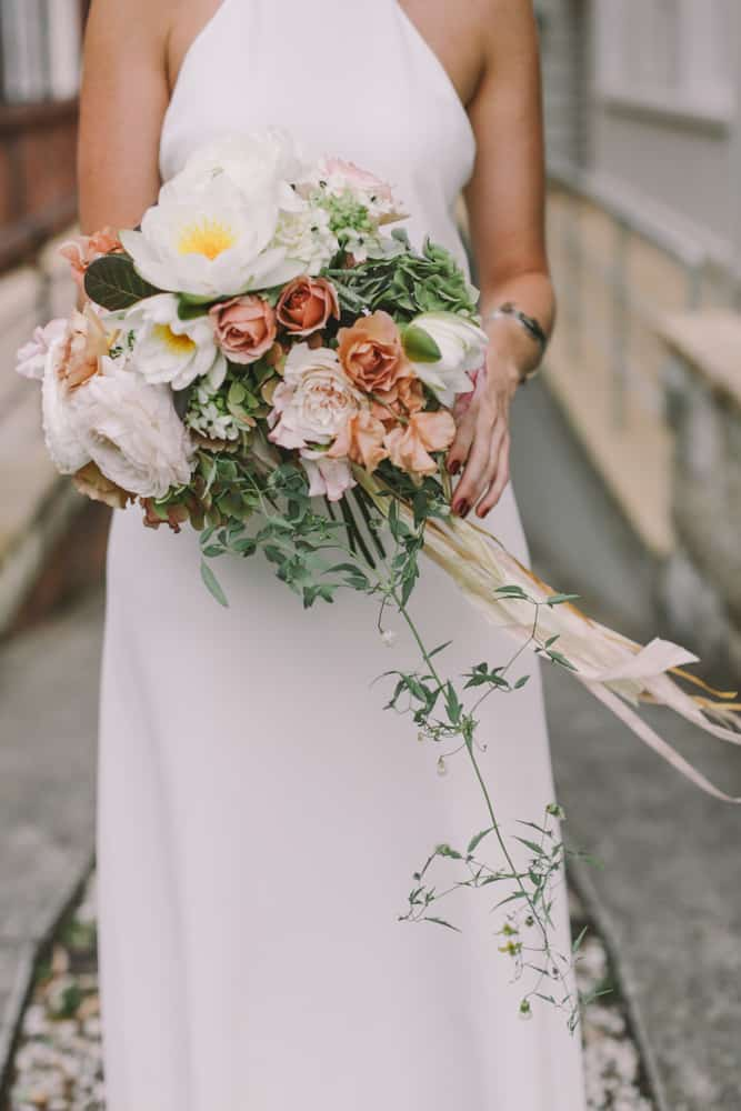 Peach toned bouquet with water lillies