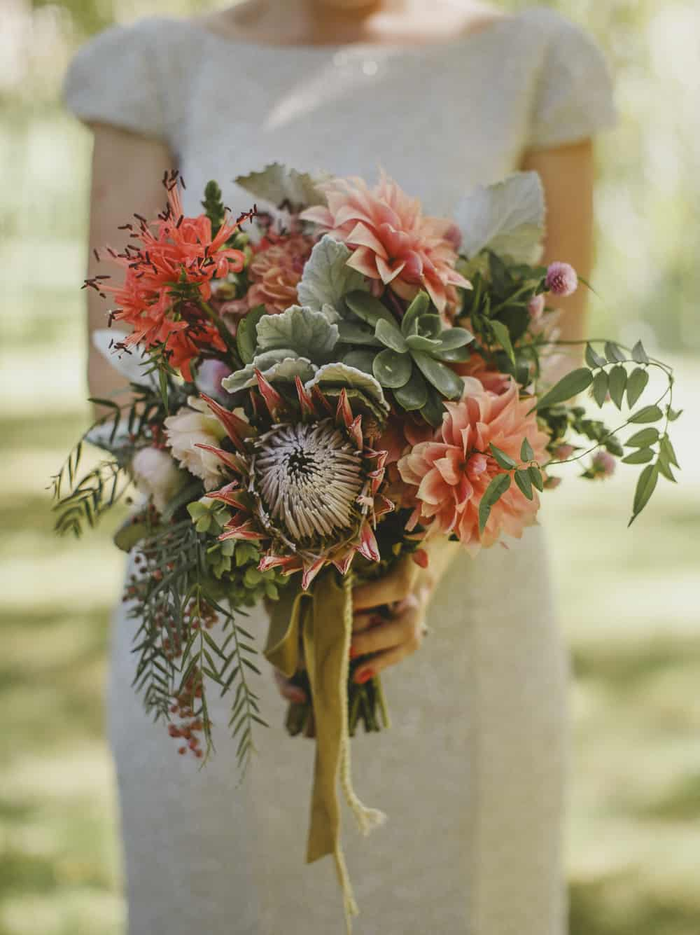 Dahlia and protea bouquet by Mikarla Bauer / Suzanne Harward gown