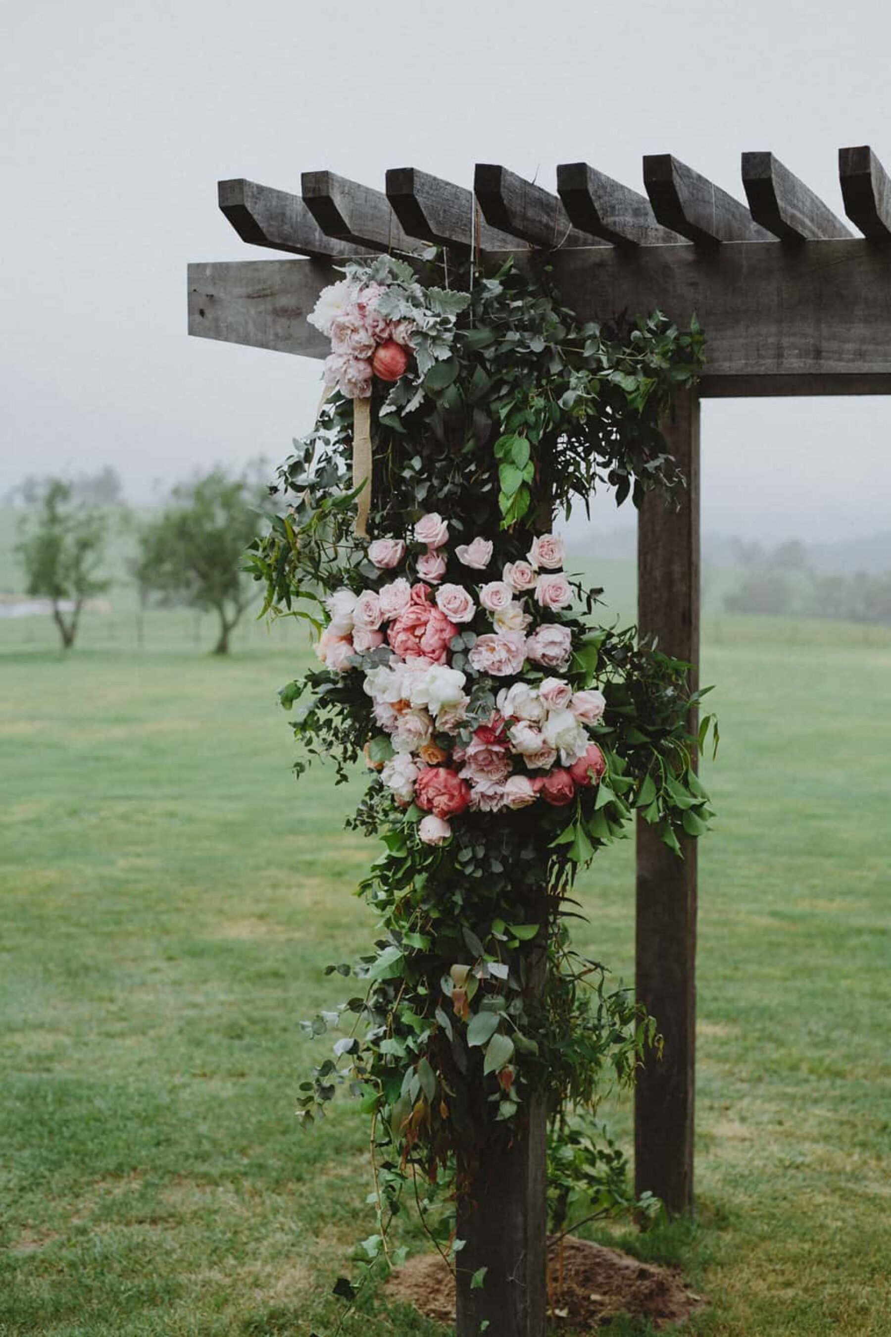 pink rose floral wedding arbour