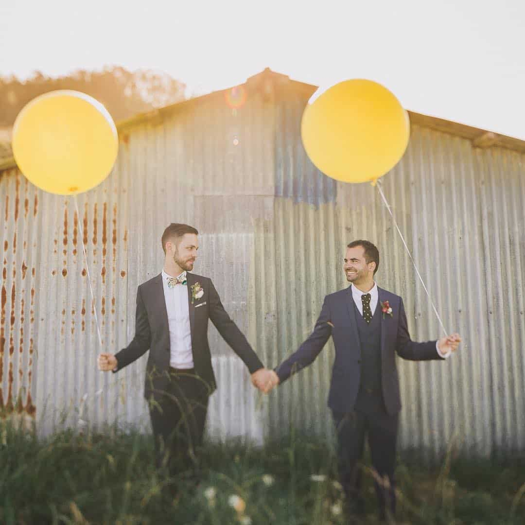 two grooms with balloons