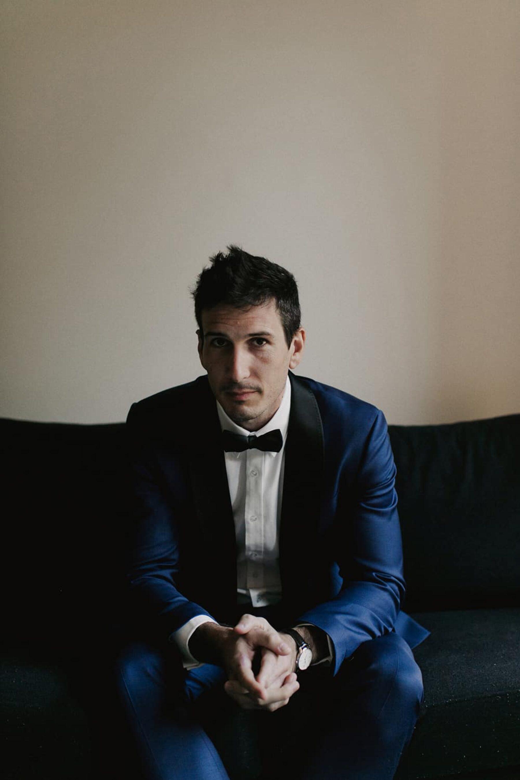 groom in cobalt blue suit
