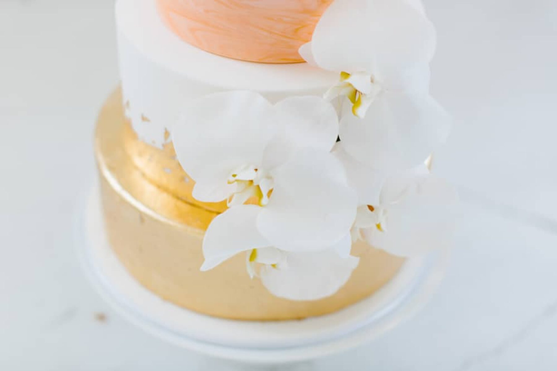 modern gold and pastel wedding cake