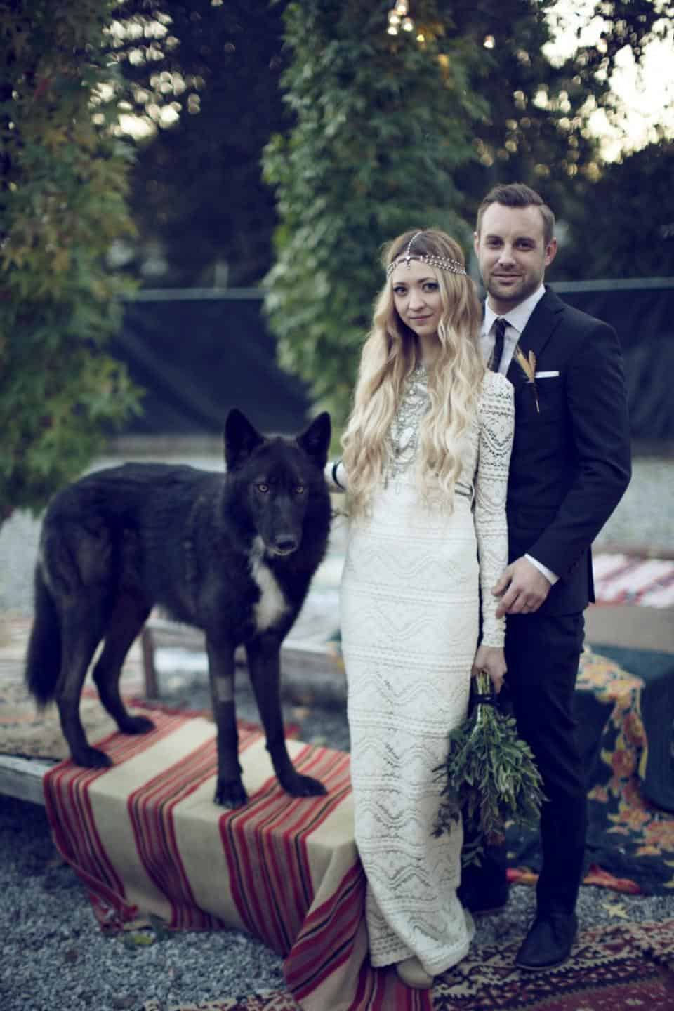 boho bride and groom with wolf