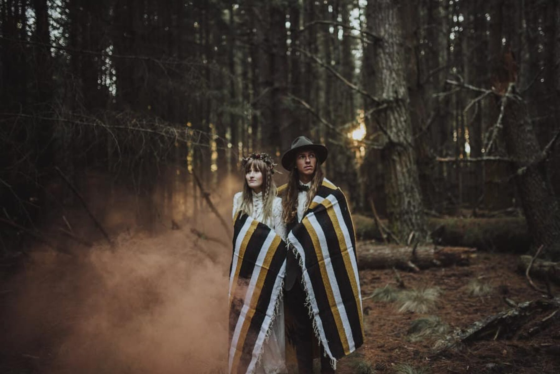 boho bride and groom with smoke bomb