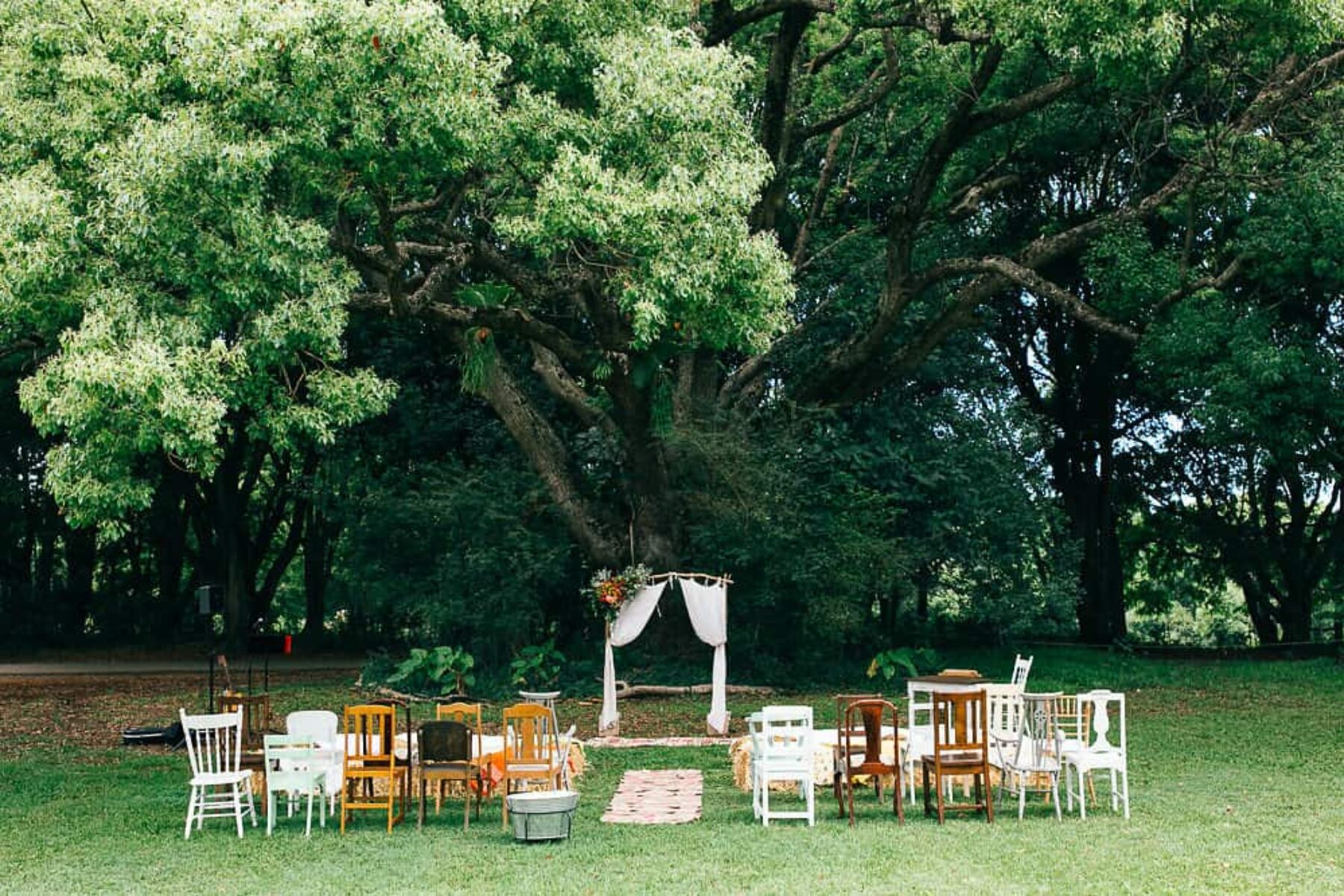 ceremony setup with mismatched vintage chair