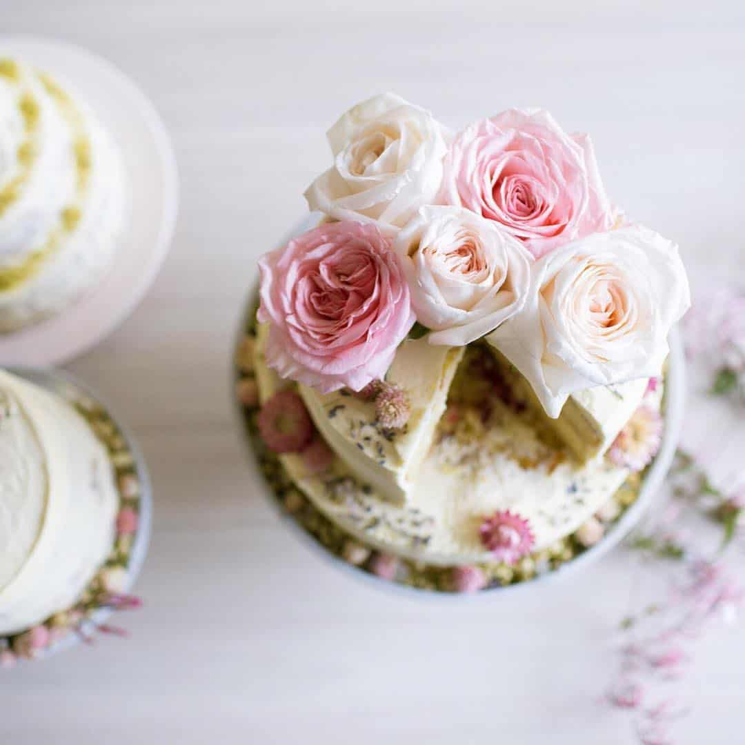 rose-topped wedding cake by Auckland baker The Caker