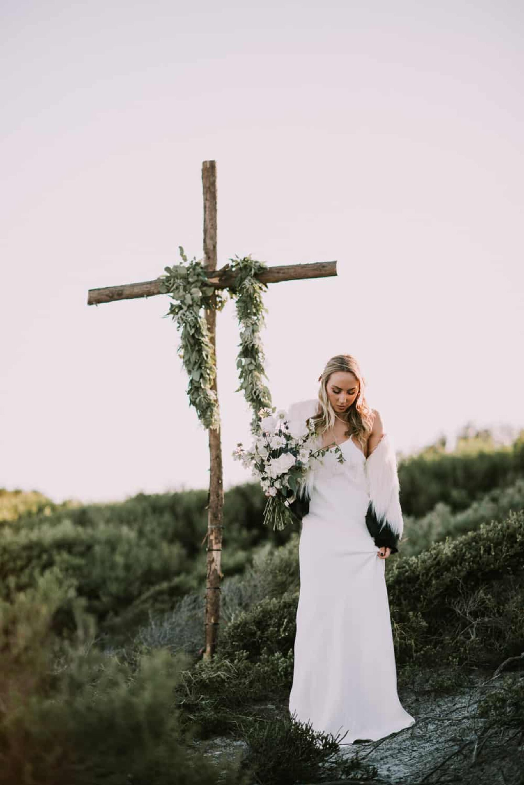 boho cross with floral garland