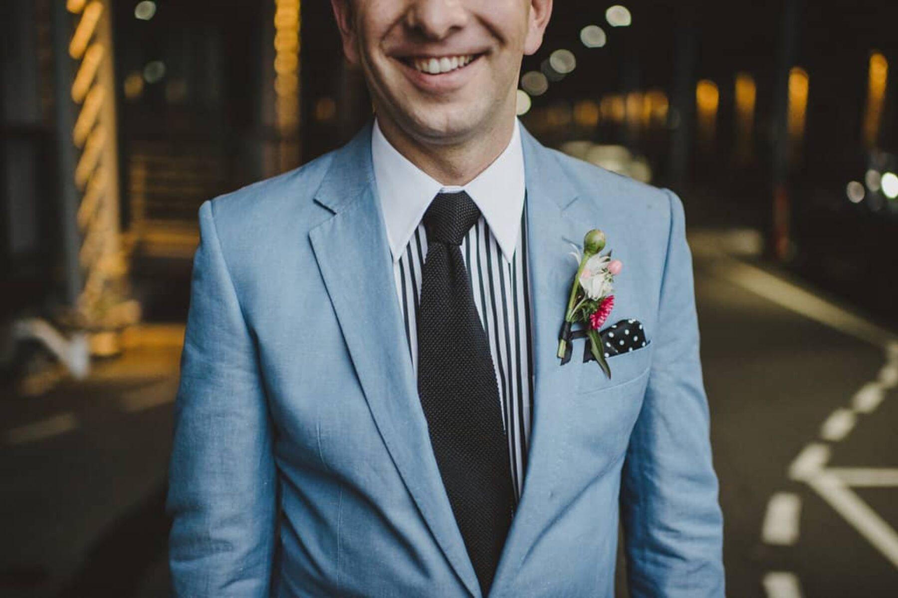 stylish groom in sky blue suit