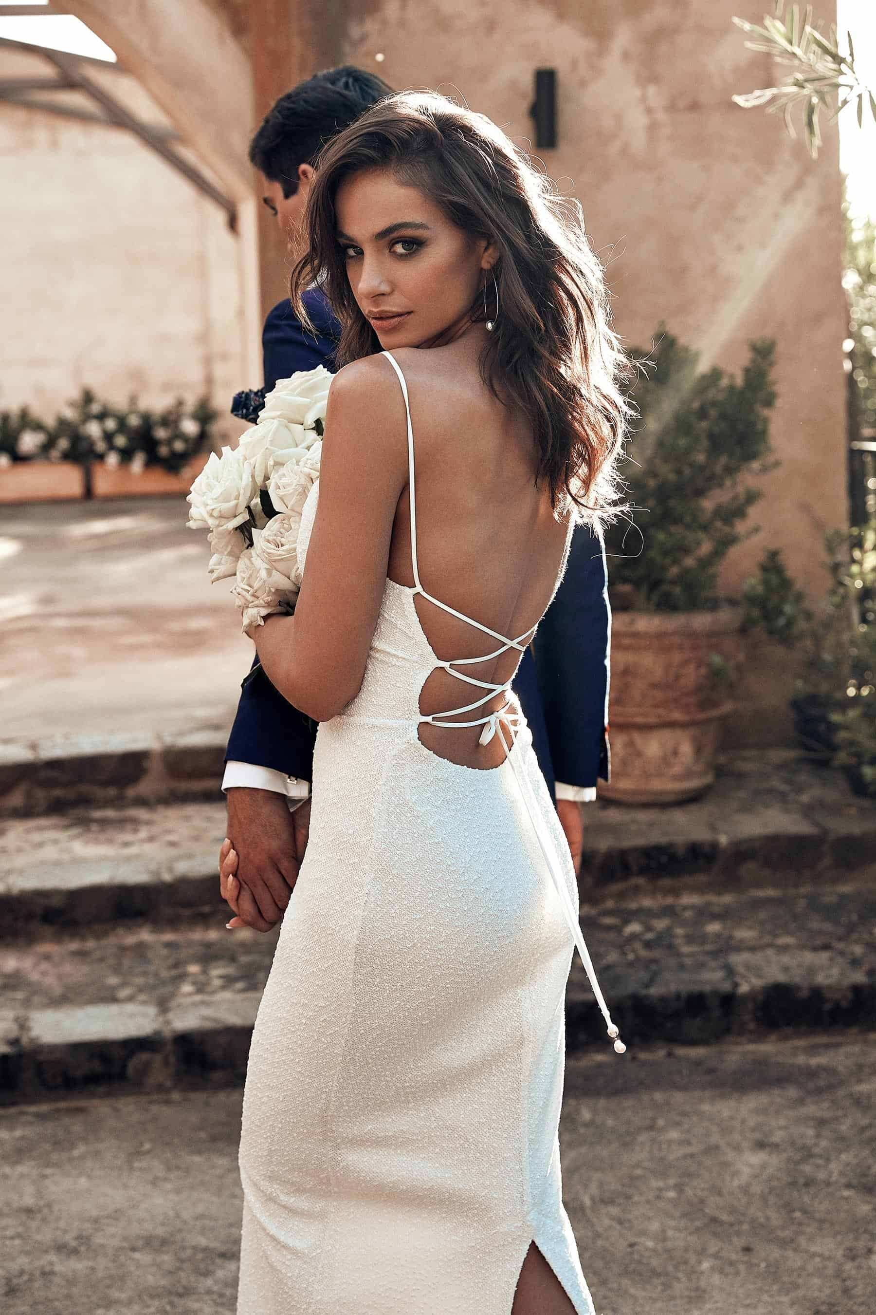 minimal wedding dress with lace-up back by Grace Loves Lace