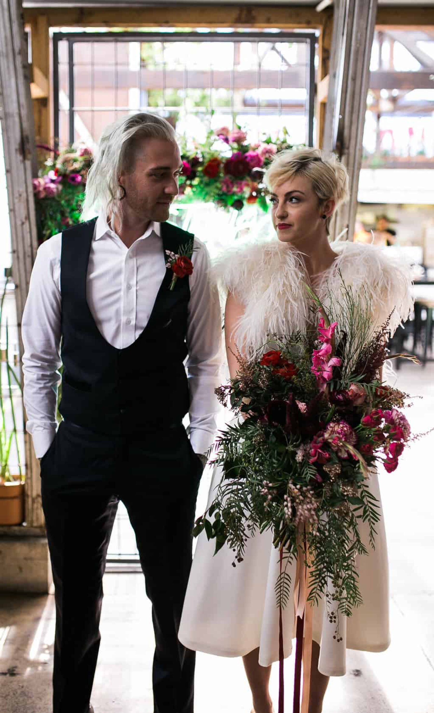 cool bride and groom with oversize bouquet