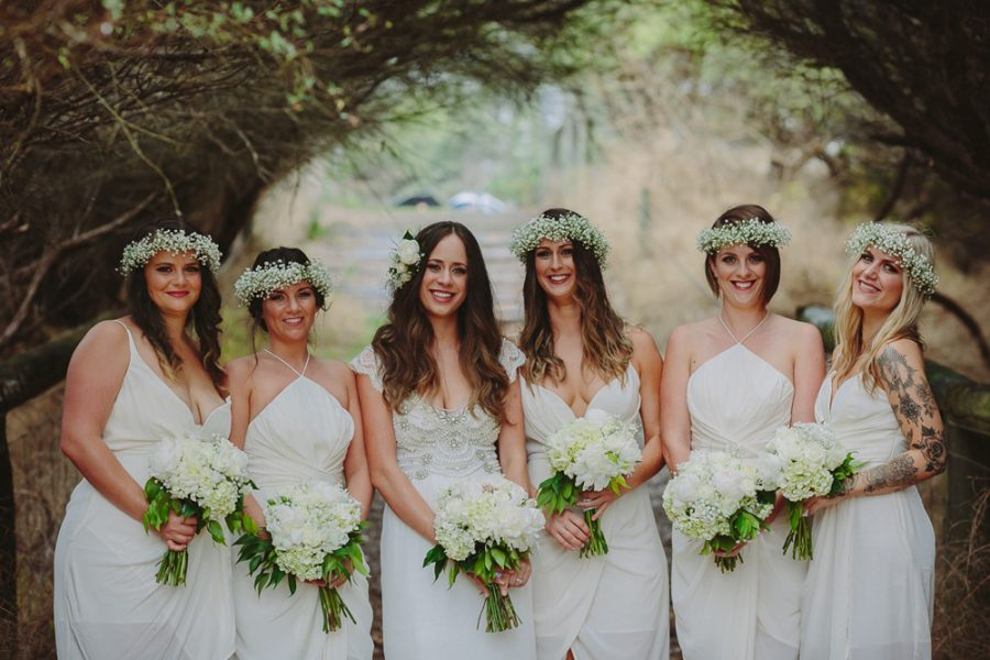 bridesmaids in white Zimmermann dresses and baby's breath flower crowns