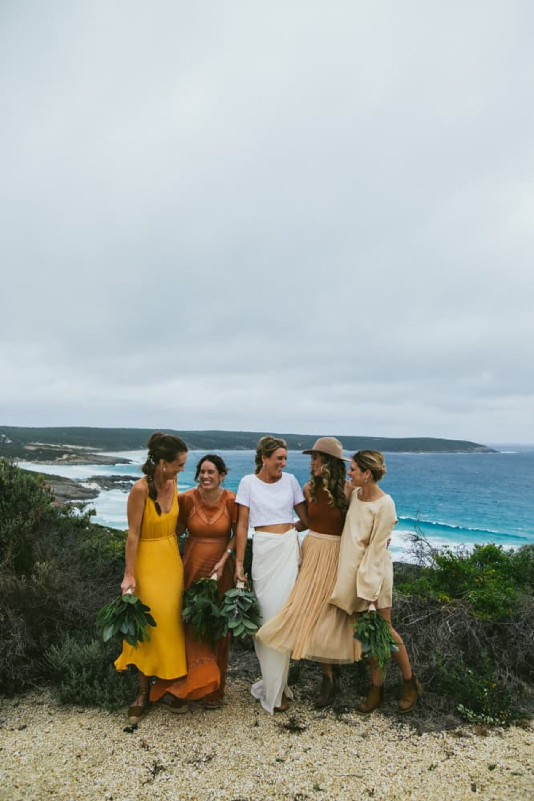 mismatched autumnal-toned bridesmaid dresses