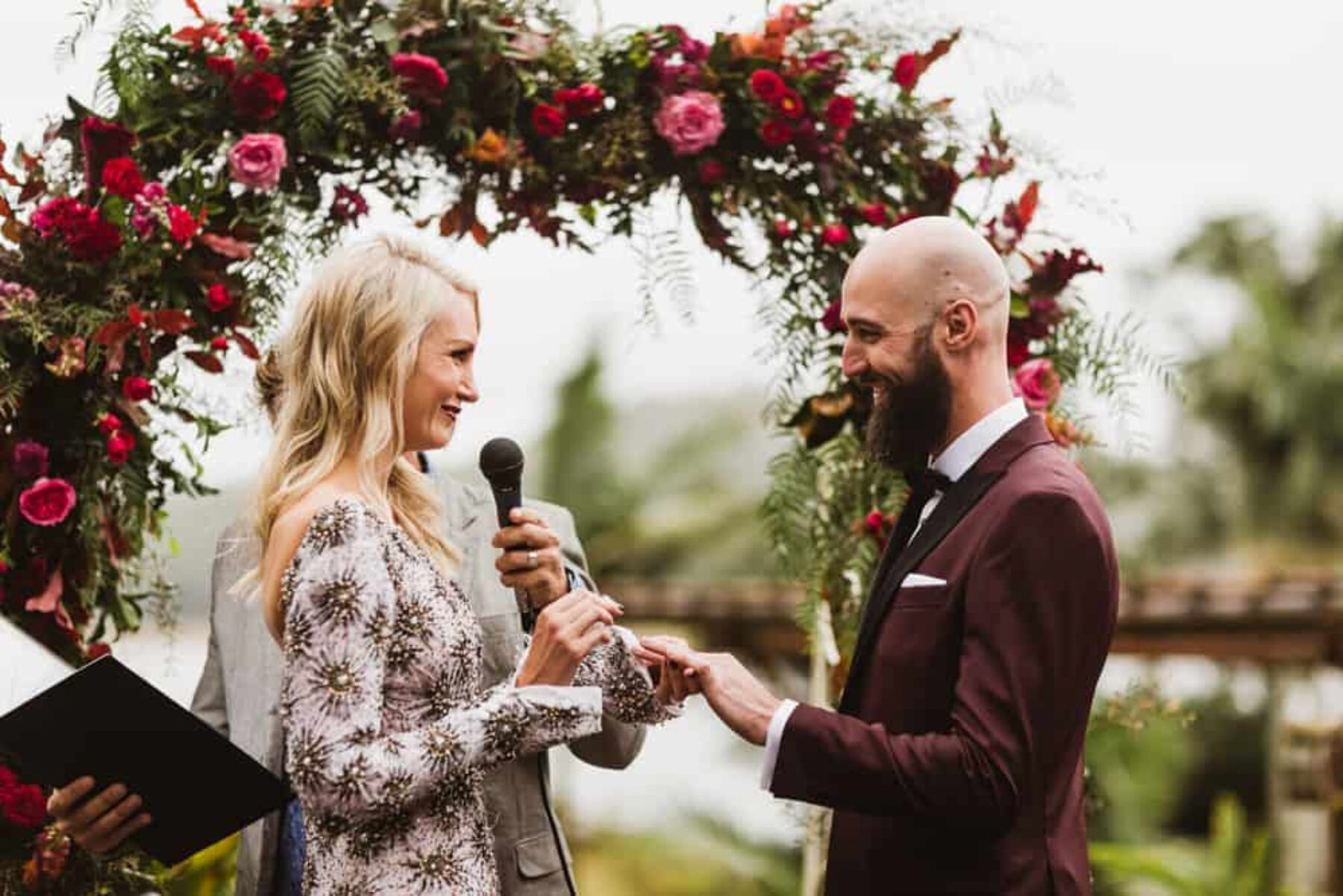 berry-toned floral wedding arch