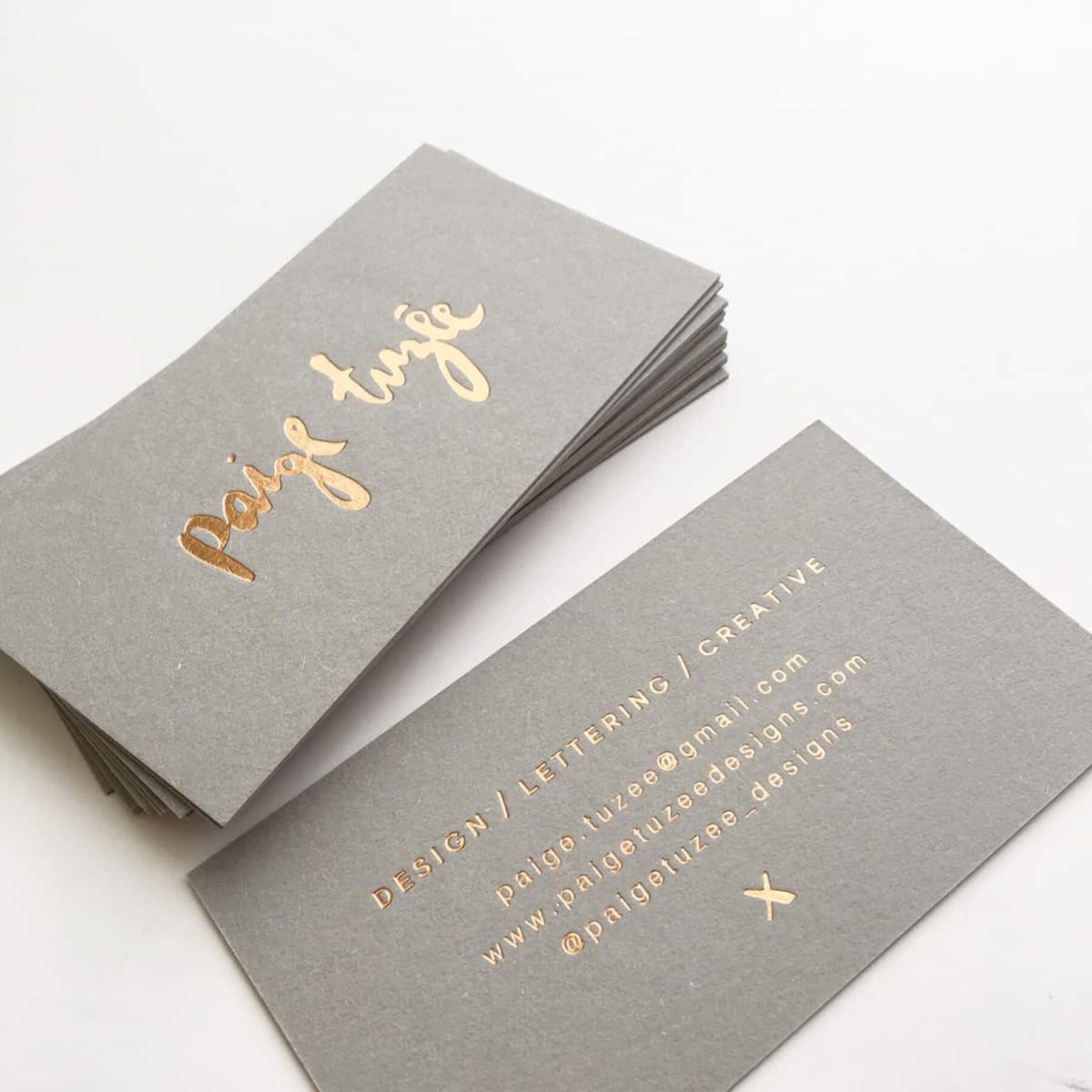 gold-foiled letterpress business cards by Paige Tuzee