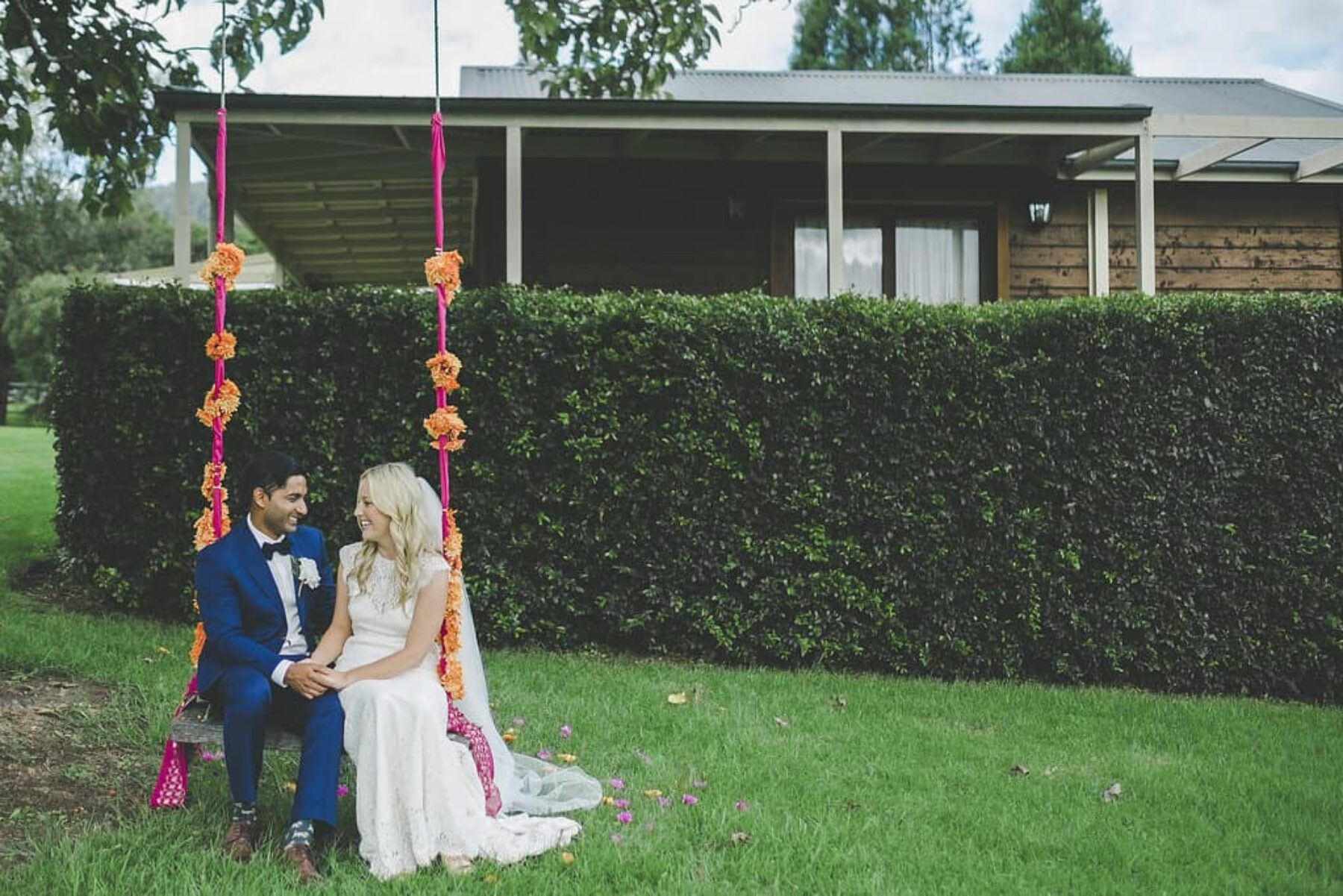bride and groom on swing