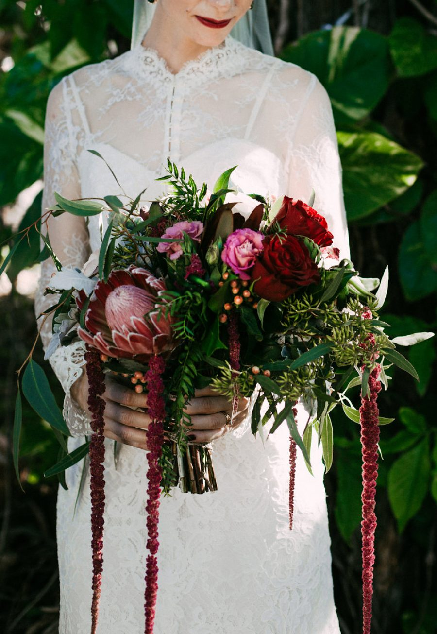 deep red bouquet with amaranth and protea