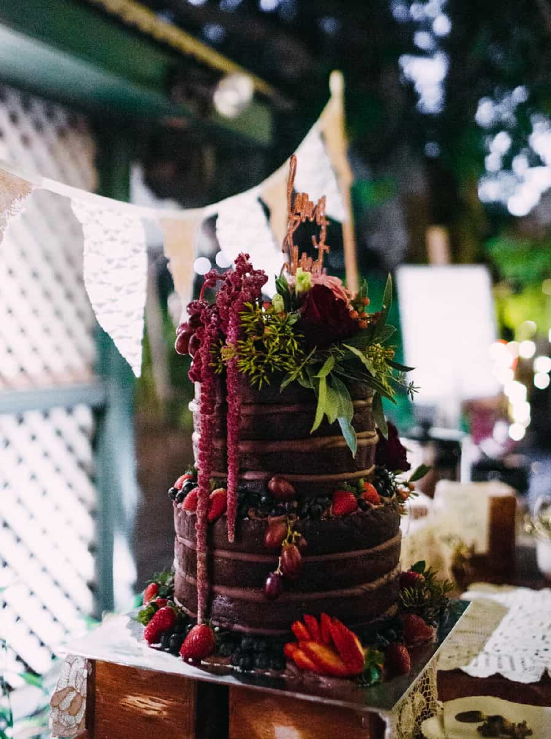 chocolate wedding cake with amaranth topper