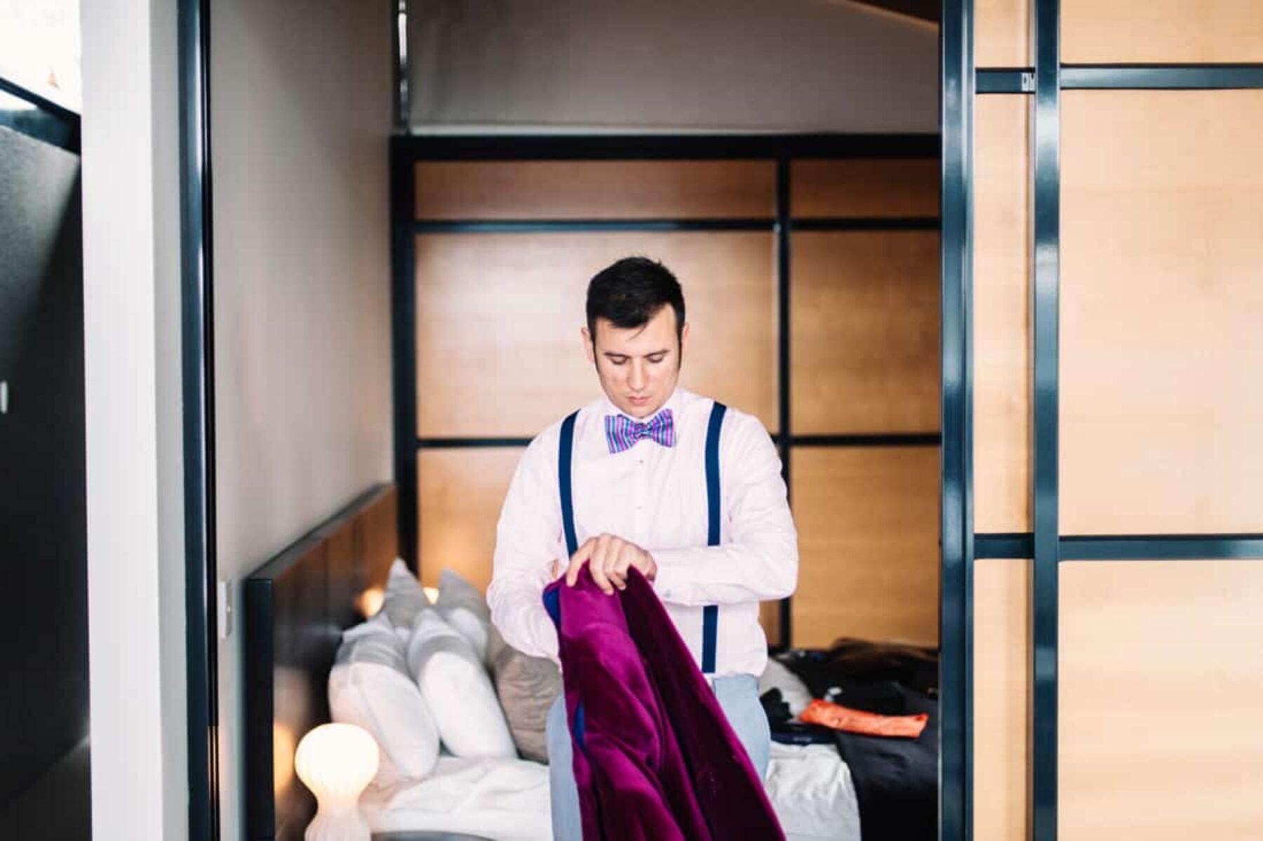 stylish groom in magenta velvet blazer