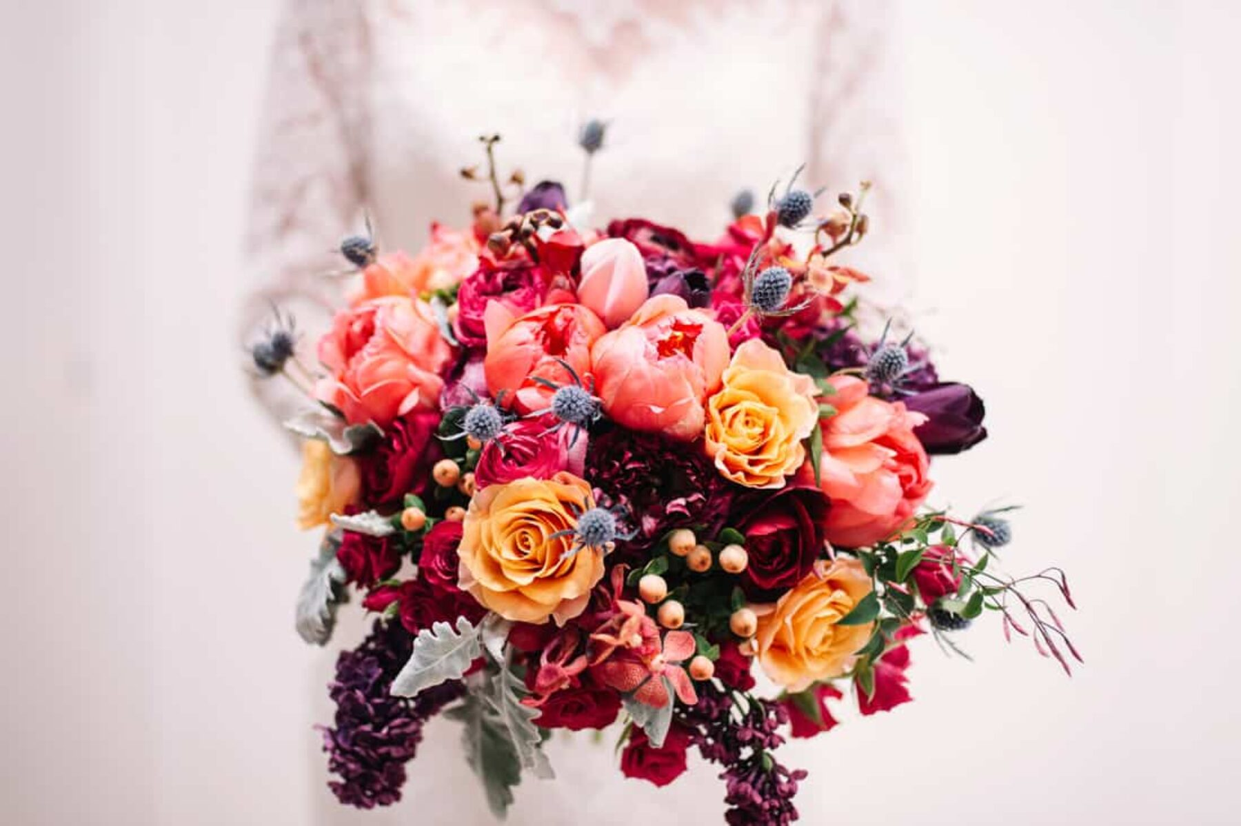 peach bouquet with tulips, roses and thistle