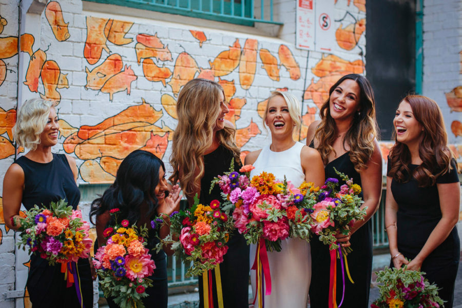 colourful bridesmaid bouquets with ribbons