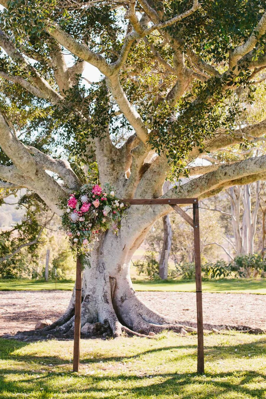 timber floral wedding arbour