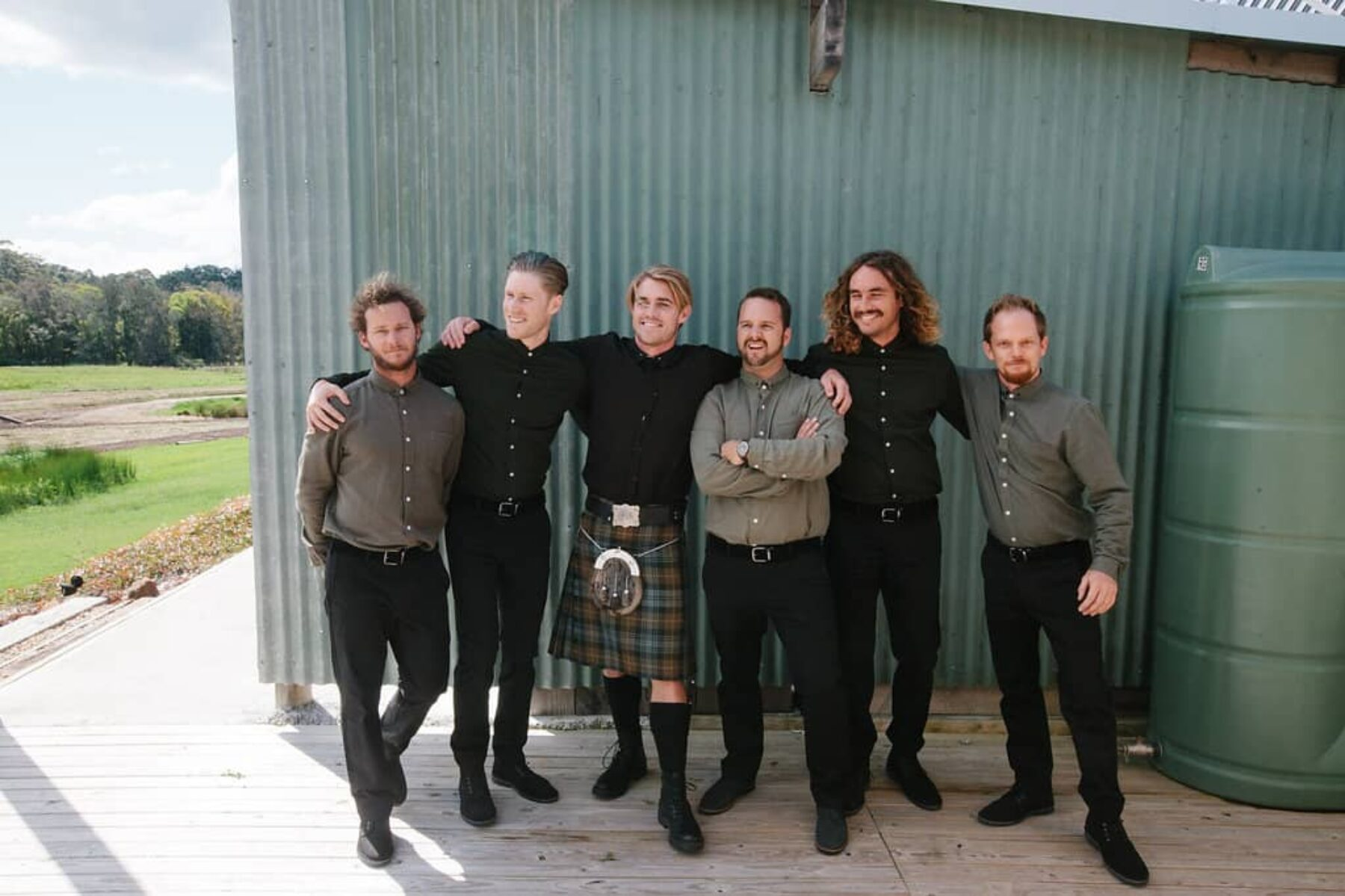 groom in tartan kilt with groomsmen