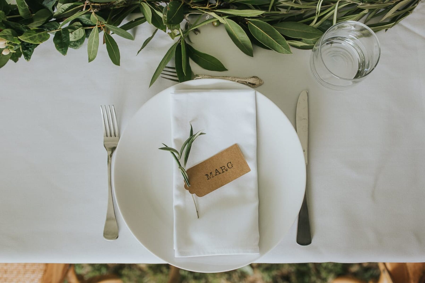 rustic table setting with olive leaf runner