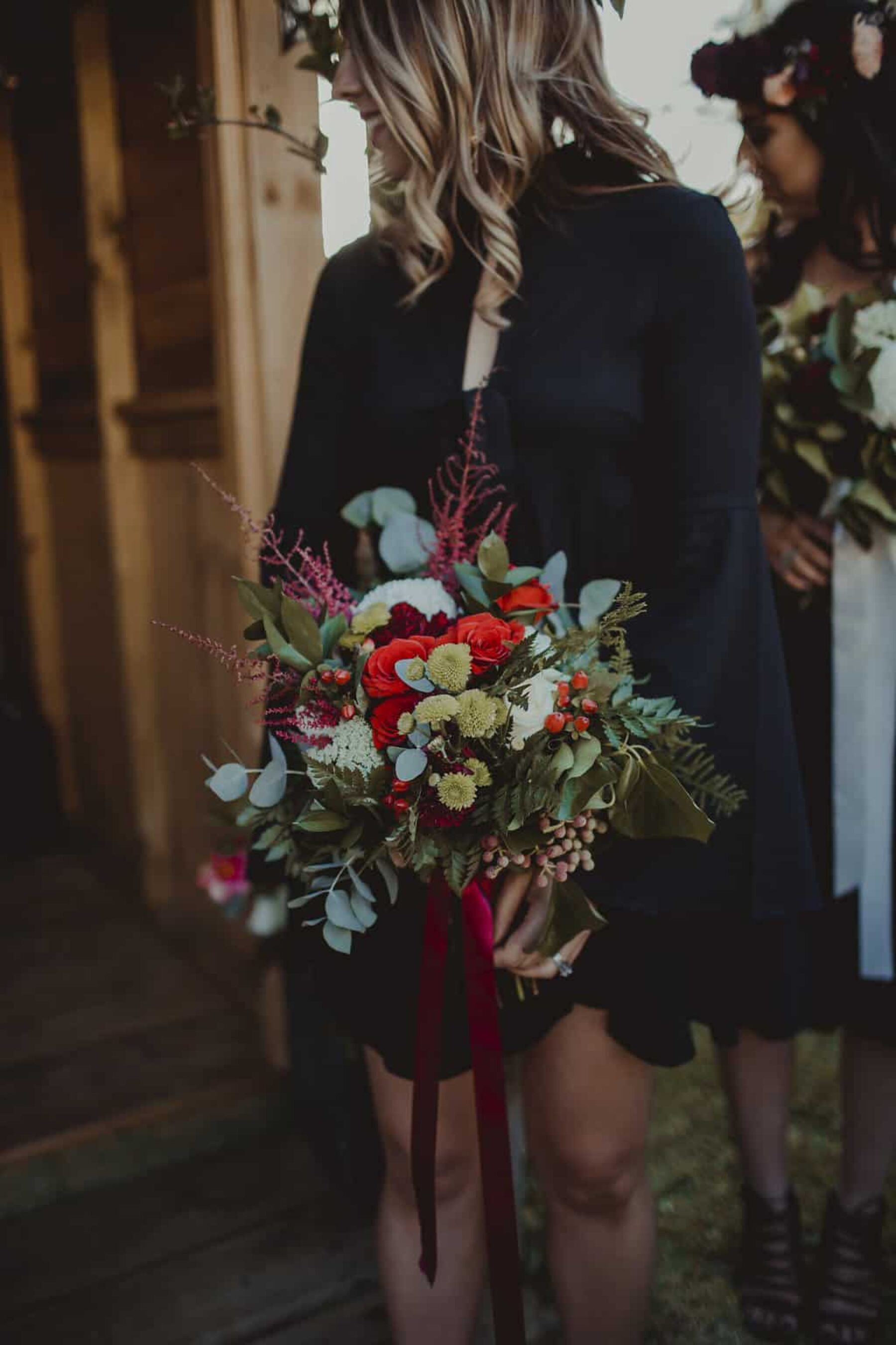 red and green bridesmaid bouquet
