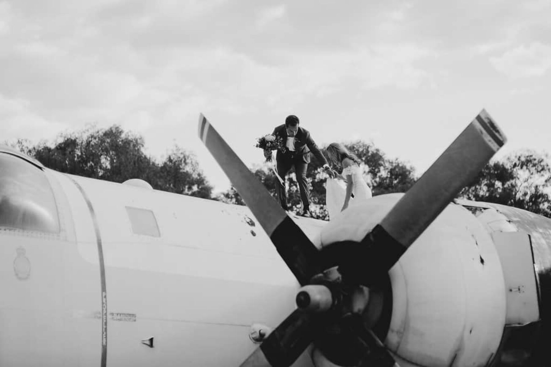 bridal party on vintage plane