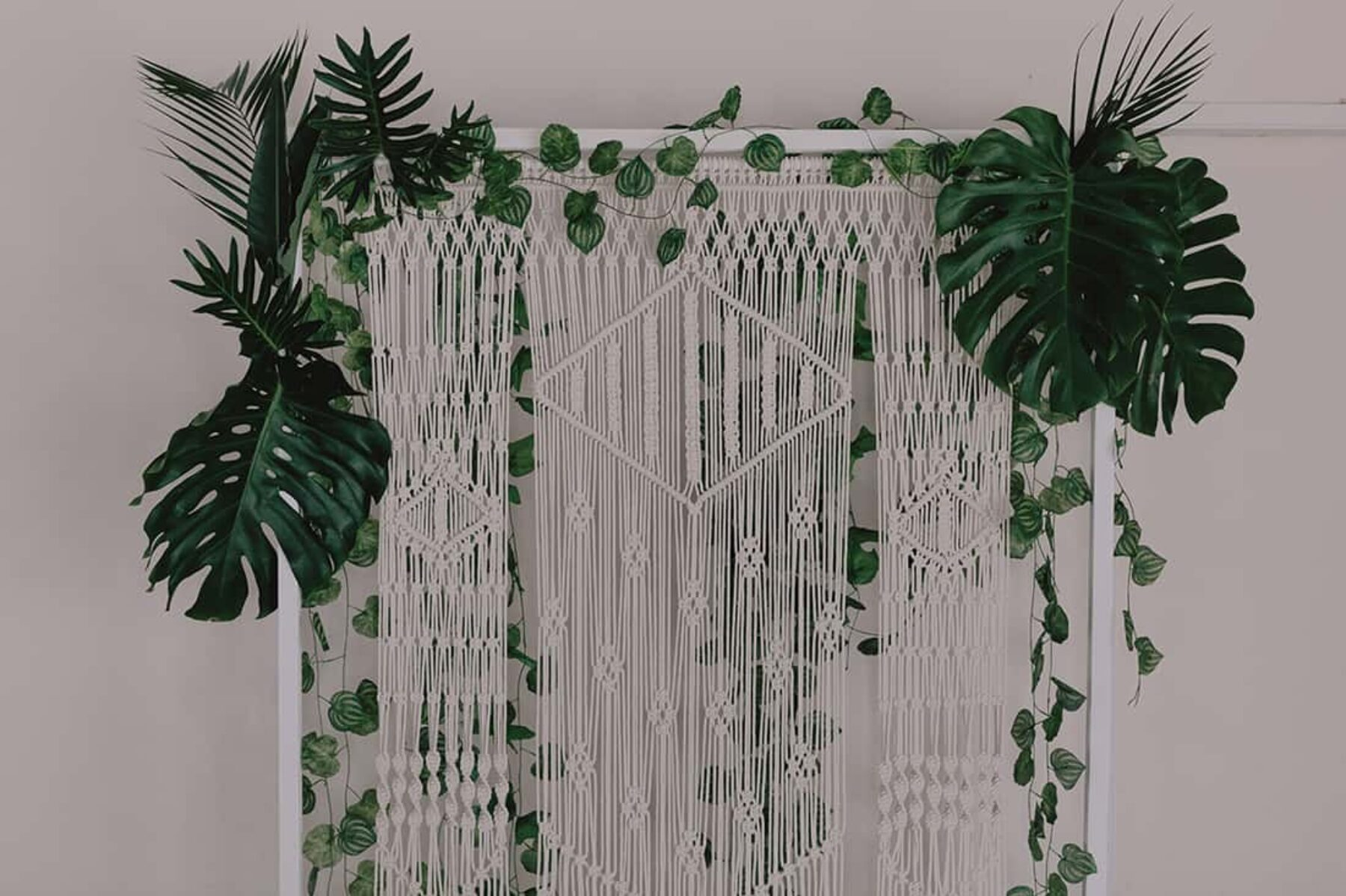 modern greenery wedding with macrame backdrop