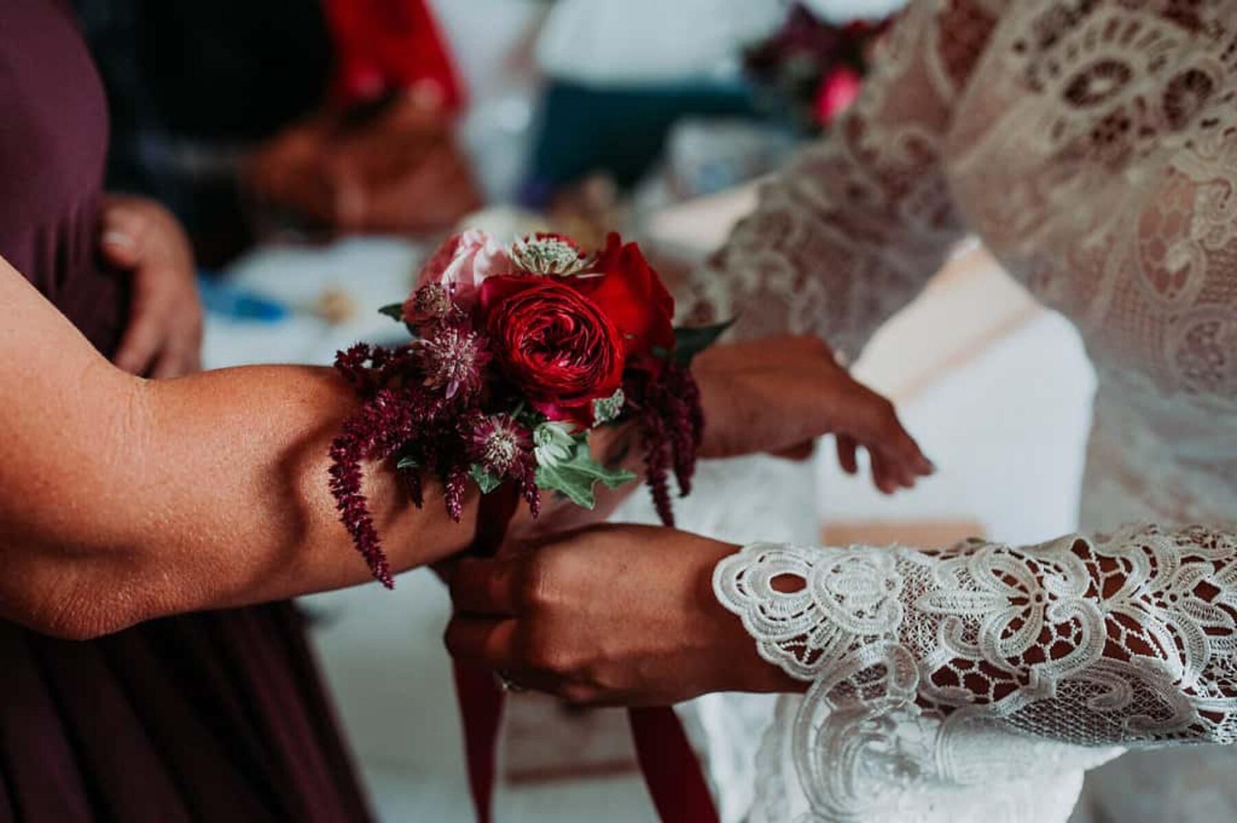 red wedding corsage