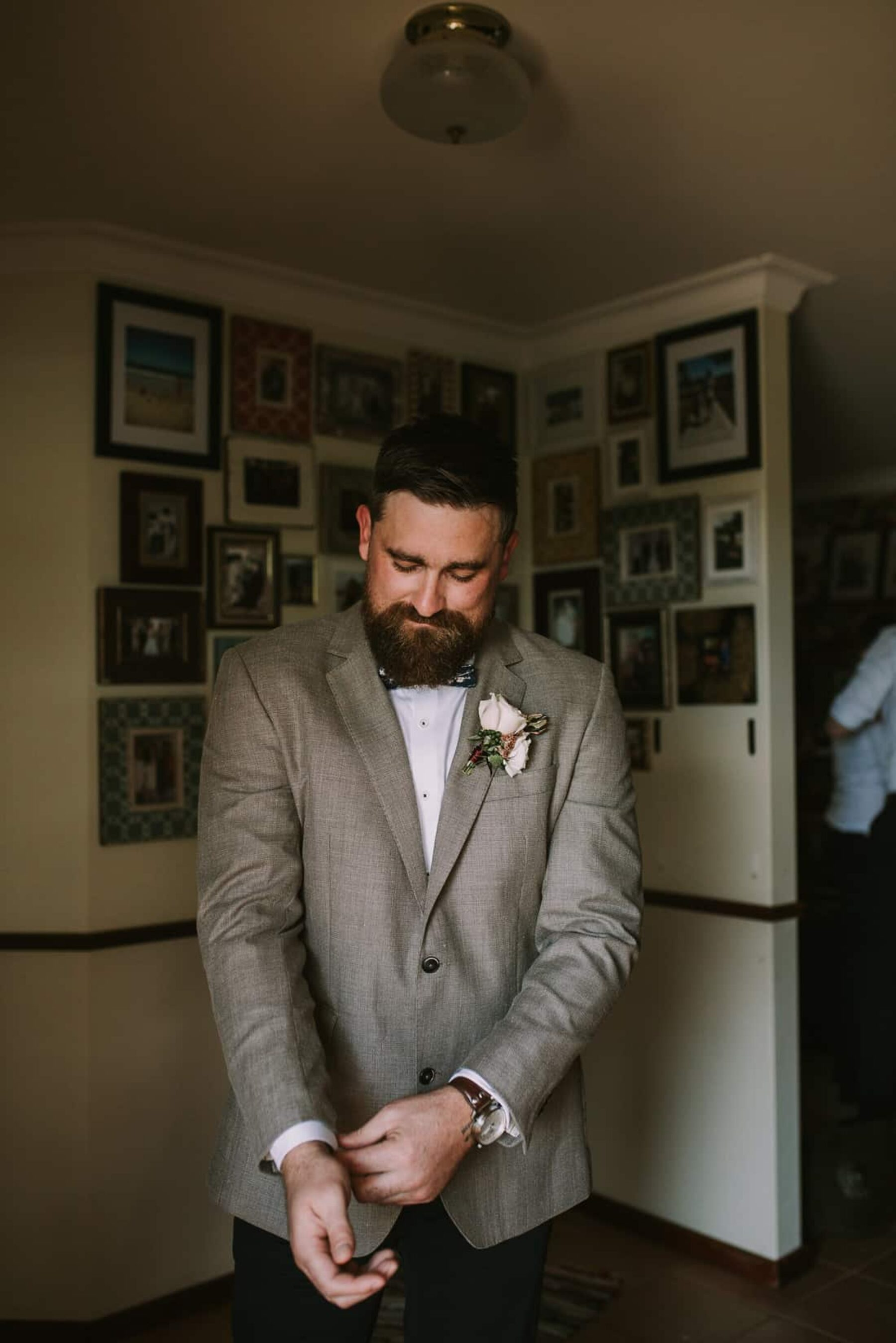 bearded groom in grey jacket