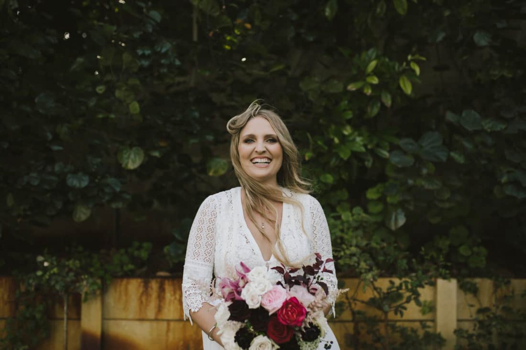 boho bride with blush and burgundy bridal bouquet