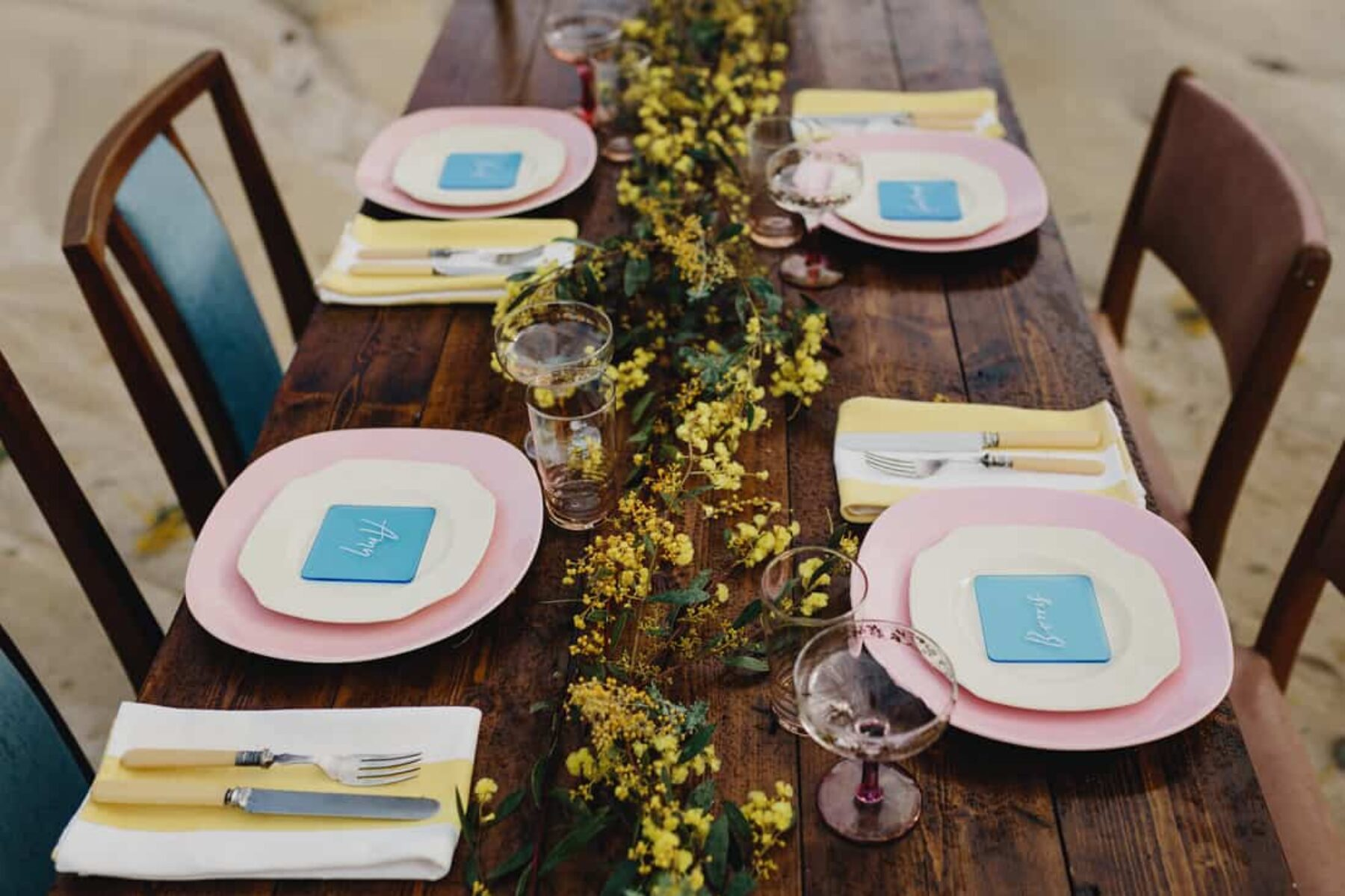 retro pastel tablescape with pink plates