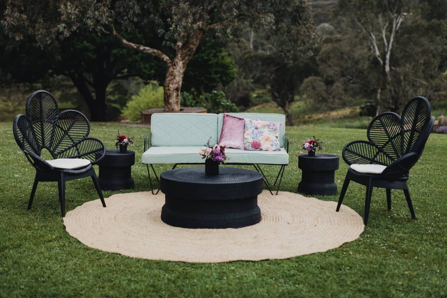 lawn lounge setup with black peacock chairs