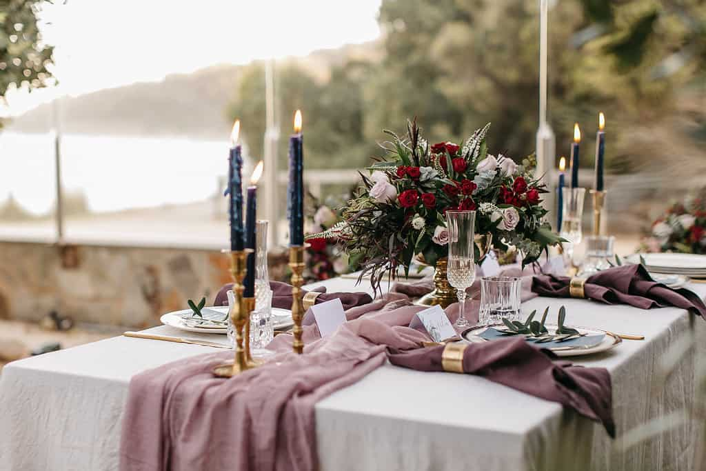 Beach wedding with blush and burgundy tablescape