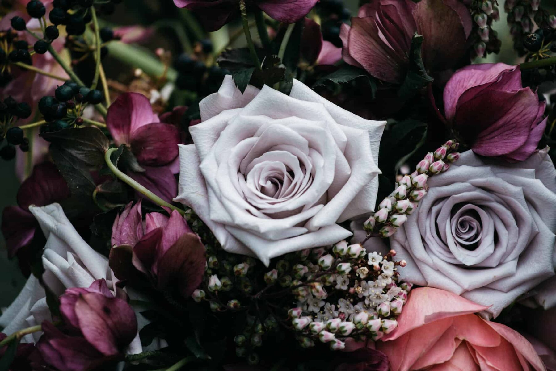 Textural bouquet in blush and burgundy hues