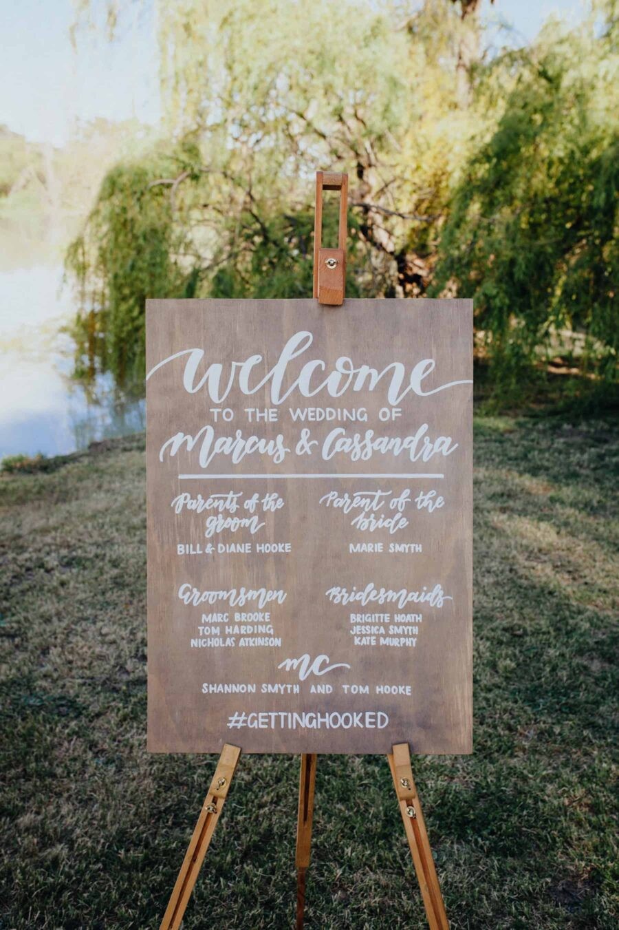 wooden hand-lettered wedding signage