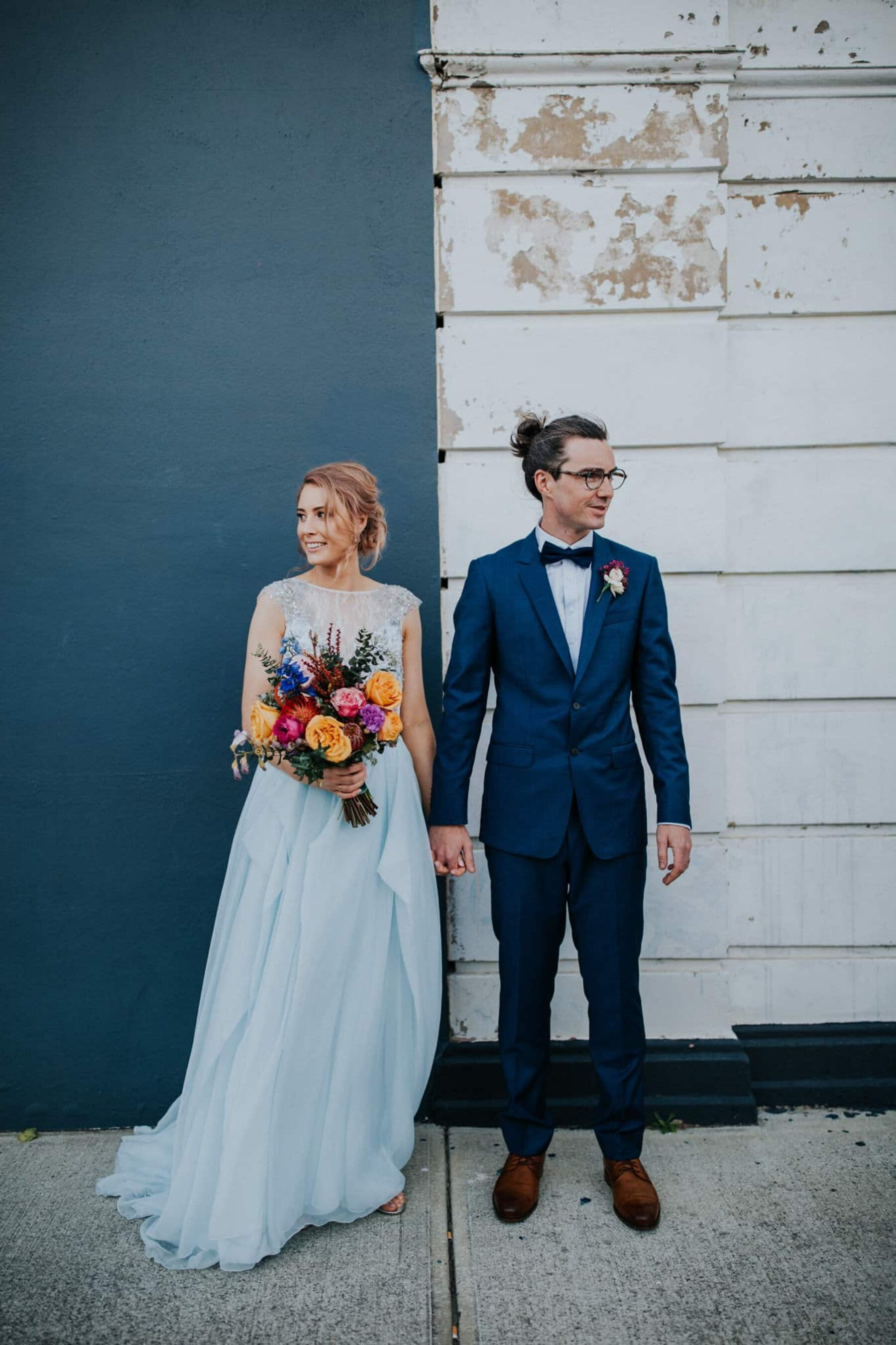 blush-haired bride with pale blue wedding dress