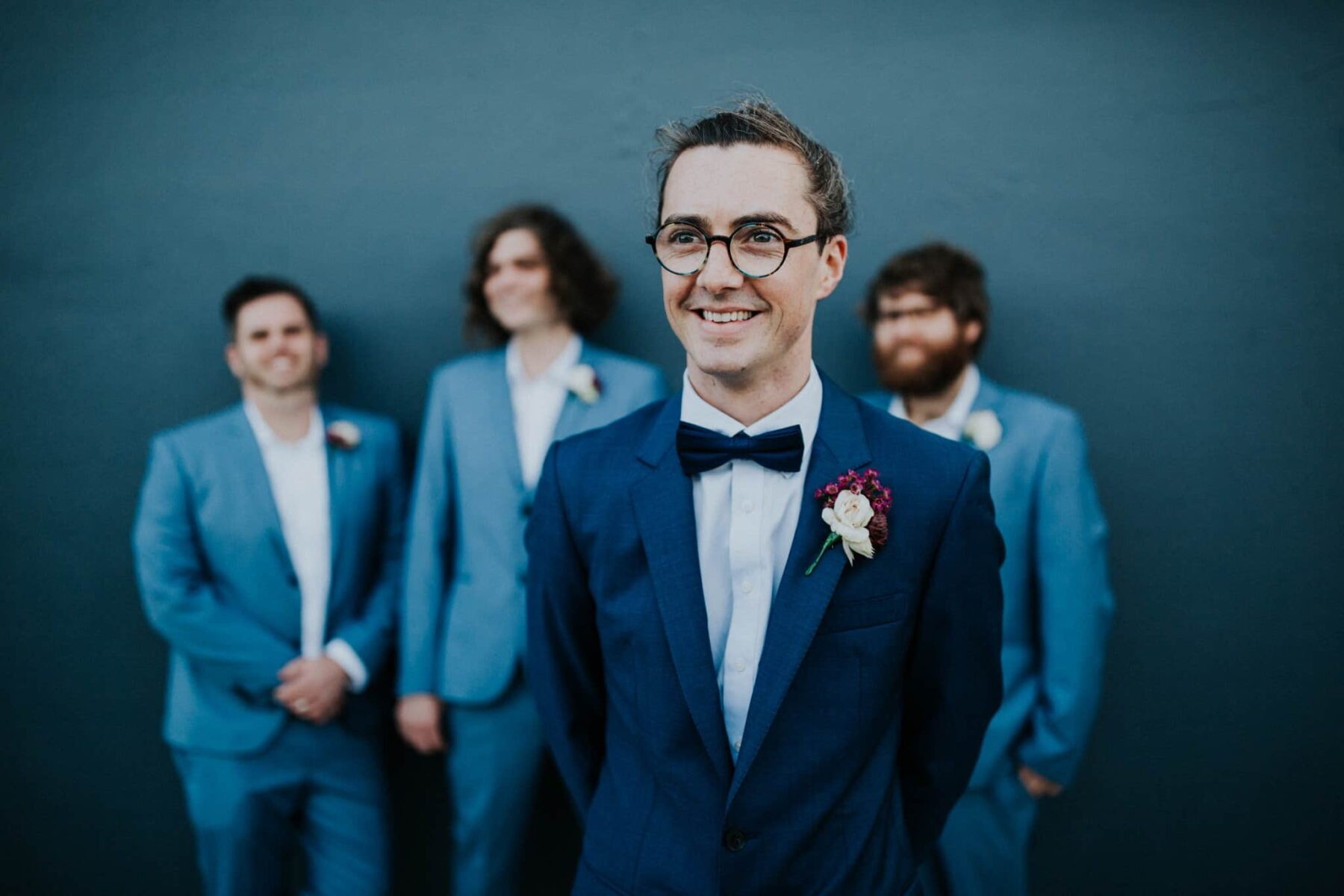 Groom and groomsmen in mixed blue suits