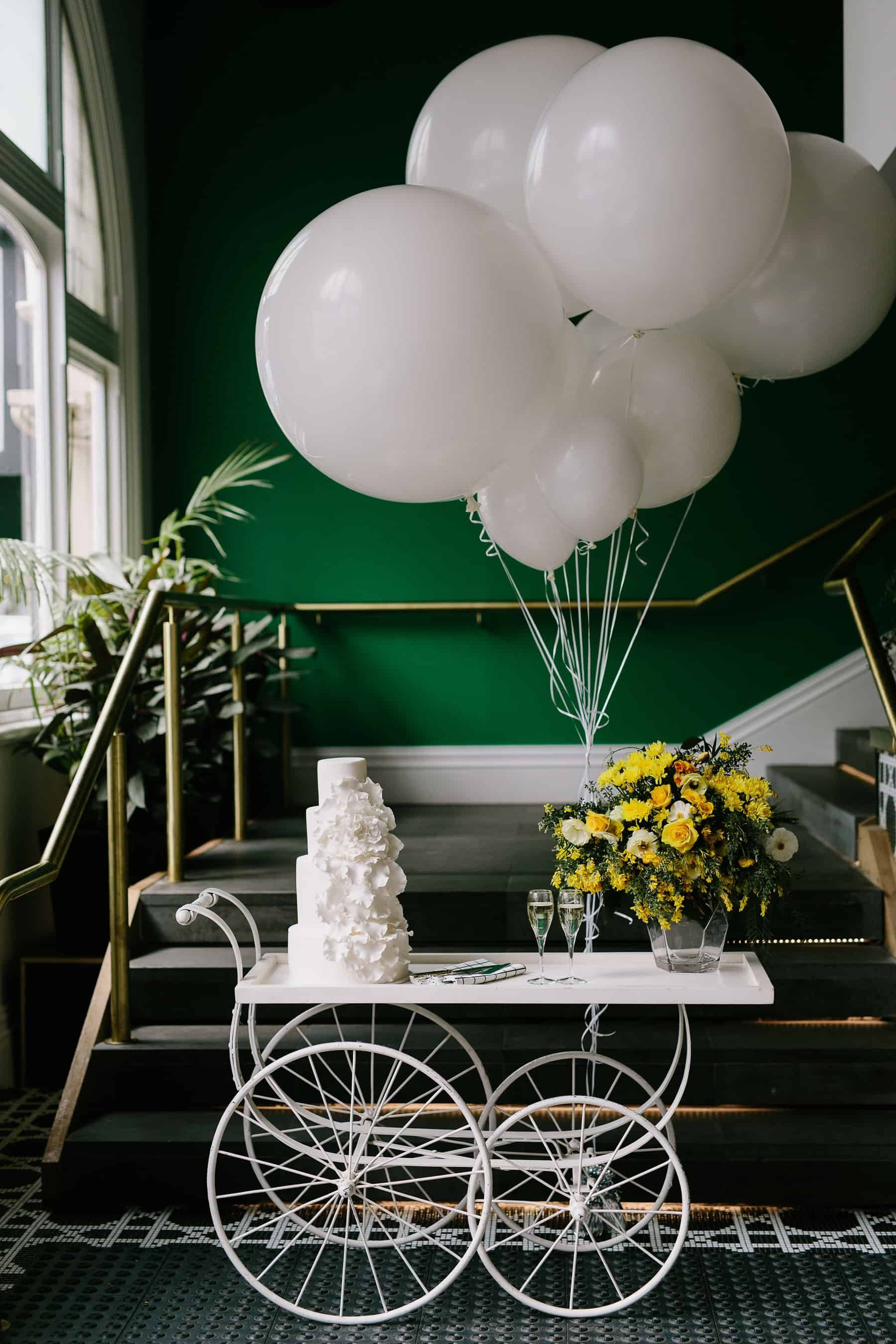 wedding cake cart with giant balloons