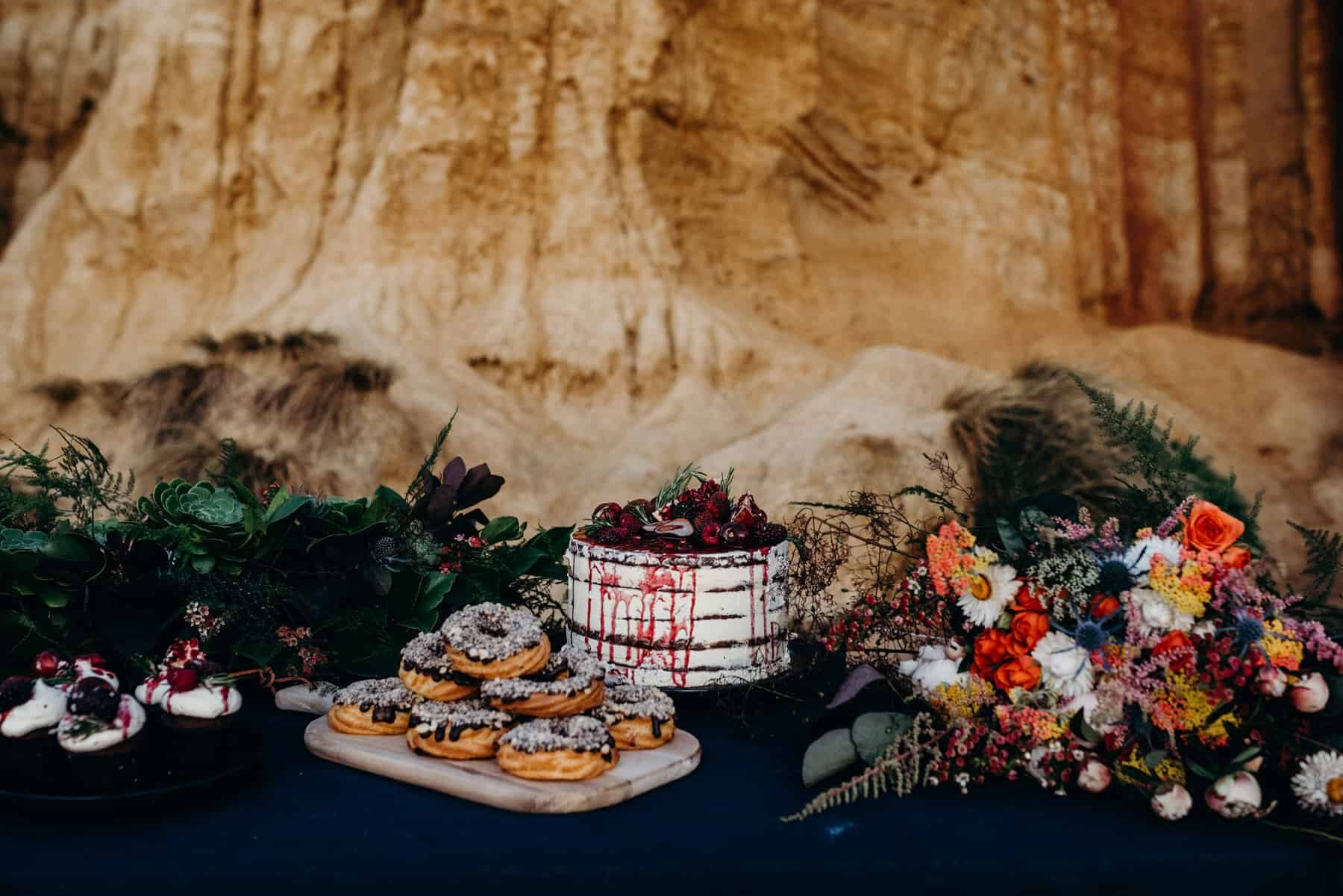 amazing dessert table set up on the beach